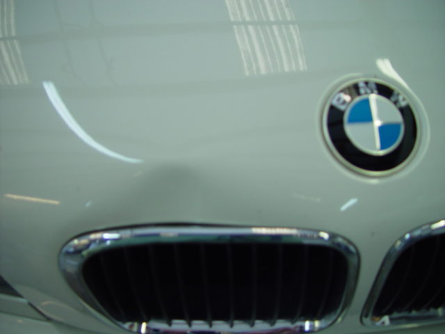 White BMW Dent