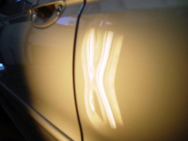 Silver Sedan Dent