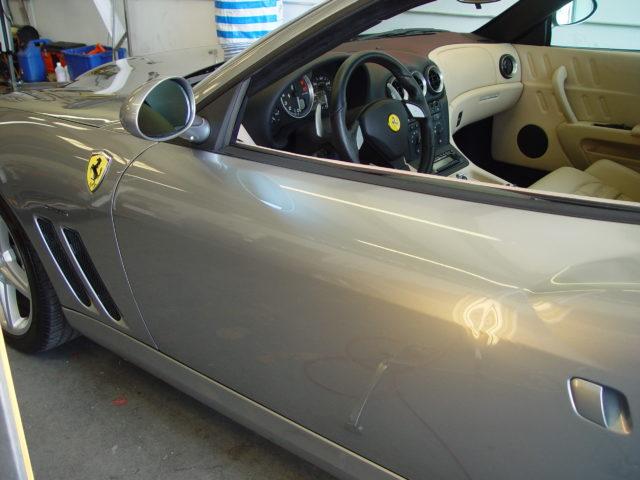 Dent in door of silver Ferrari