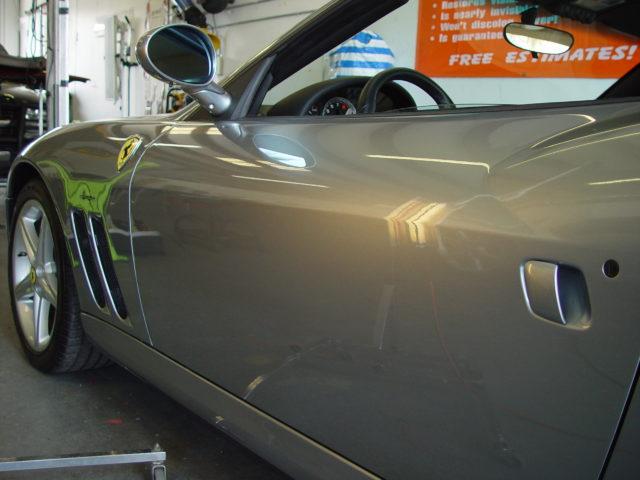 Dent repair on silver Ferrari