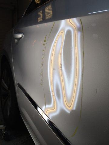 door ding on lighter body panel