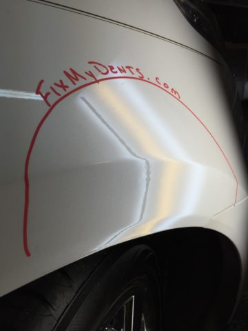 Wheel well dent repair